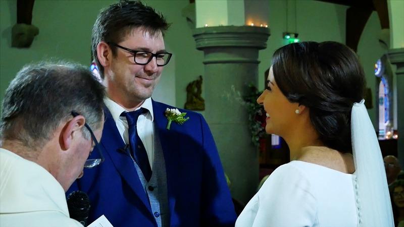 Groom-smiling-at-bride