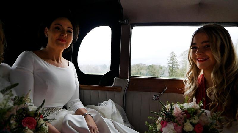 bride-smiling-in-wedding-car